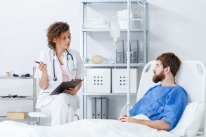 Nurse interviewing patient in hospital
